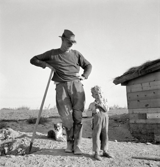"October 1939. ""Mr. Dougherty and one of the children. Warm Springs district, Malheur County, Oregon."" Photo by Dorothea Lange"